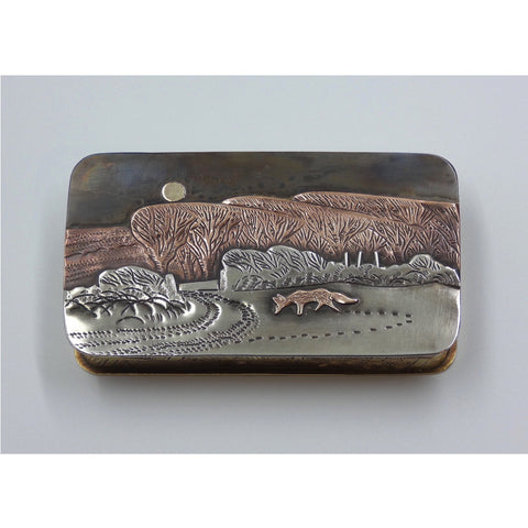 Metal hinged box depicting a fox in a snow covered field under the full moon by artist Cornelius Van Dop