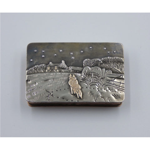Metal hinged box depicting a fox walking through a snow covered field towards a cottage in the dead of night by artist Cornelius Van Dop