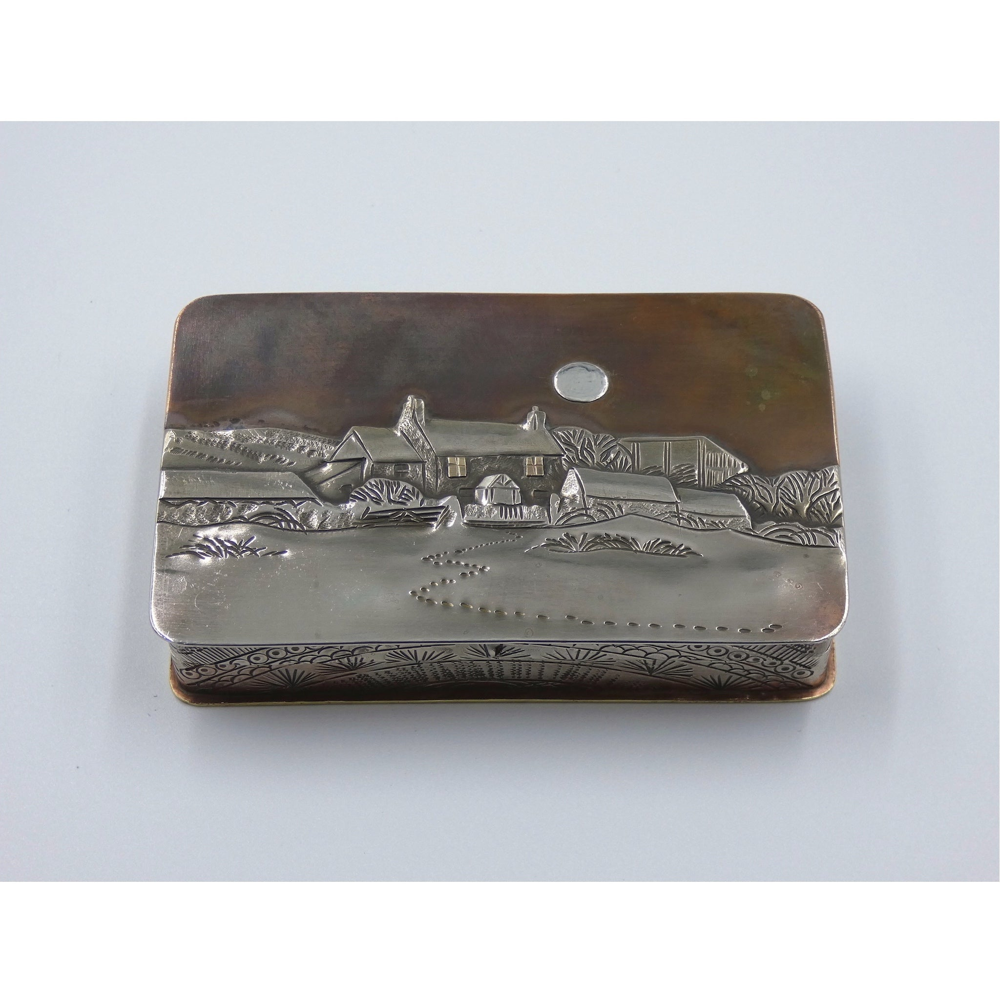 Metal hinged box depicting a cottage nestled in a snow covered landscape by artist Cornelius Van Dop