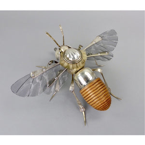 Honey bee sculpture made from found objects made by artist Dean Patman