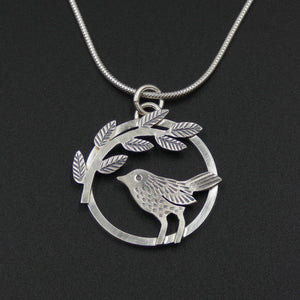 Bird and leaves circle pendant by jeweller Helen Shere