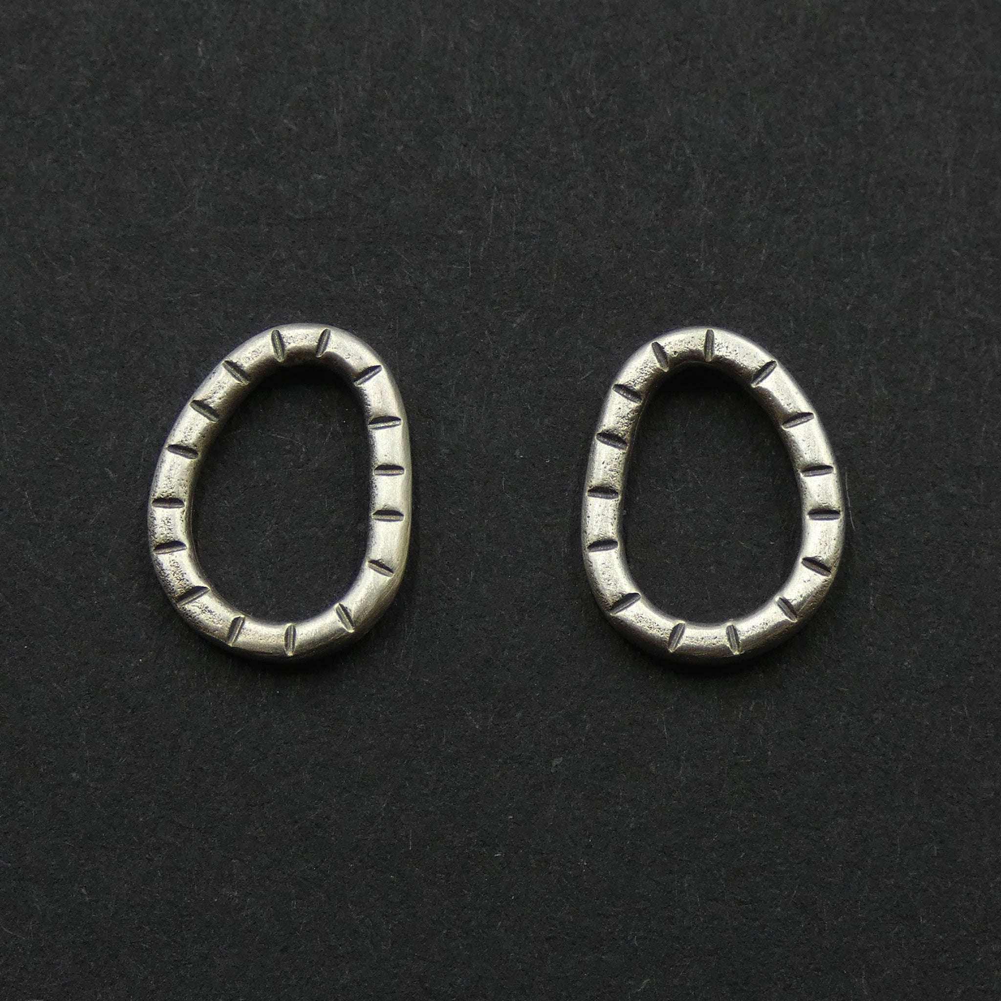 Striped hoop studs by jeweller Helen Shere