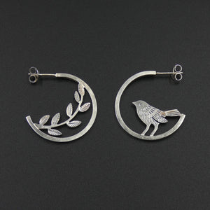 Mismatched bird and leaves hoop stud earrings by jeweller Helen Shere