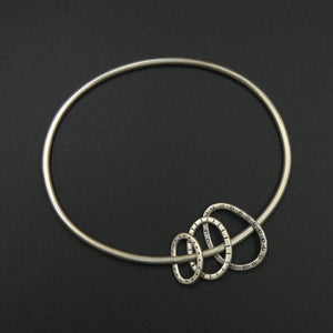 Oval bangle with three hoops by jeweller Helen Shere