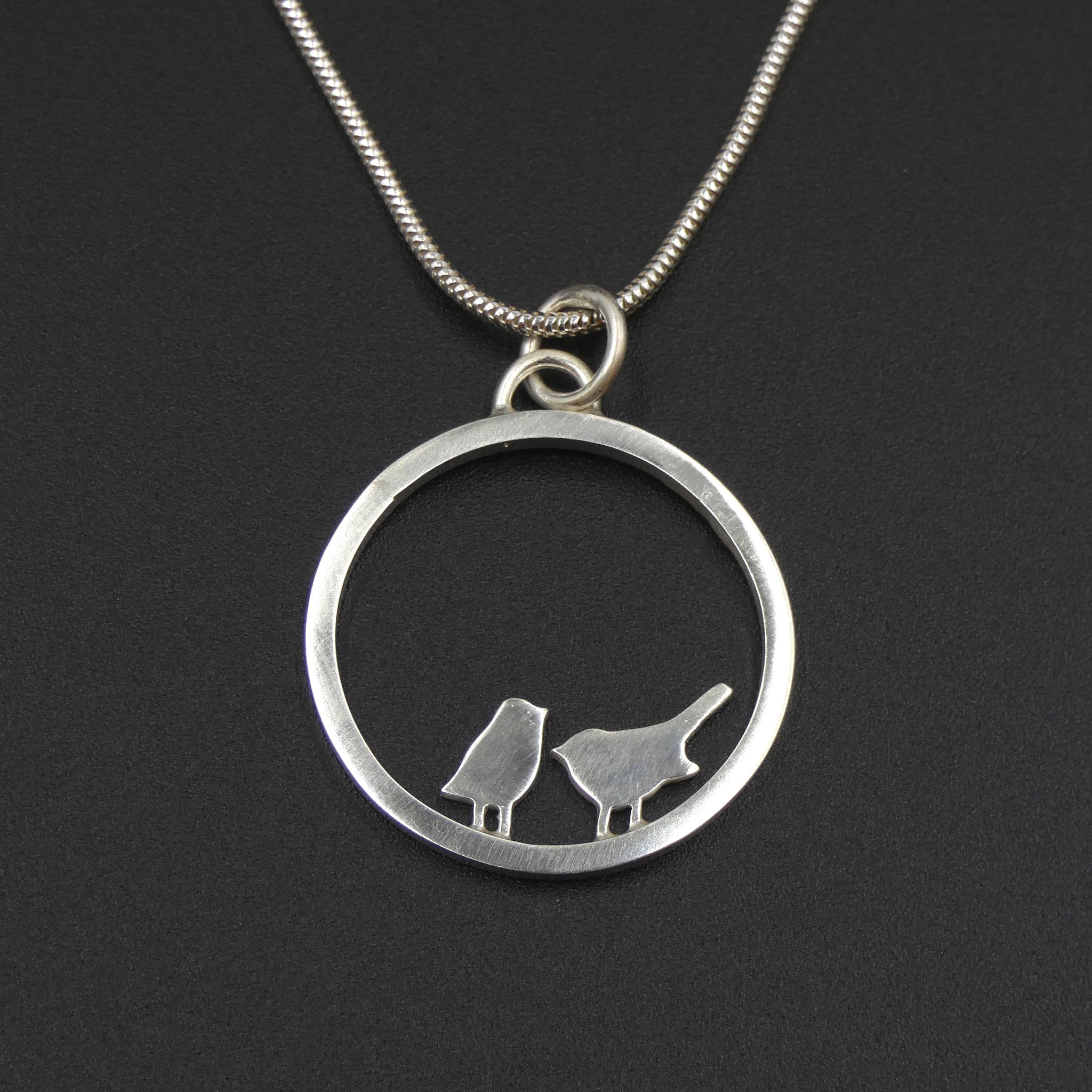 Tiny birds circle pendant by jeweller Helen Shere