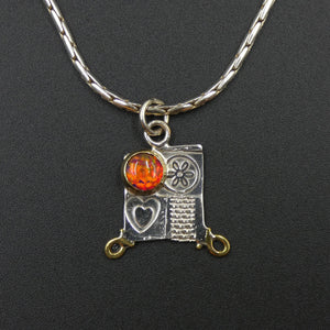 Small pendant by jewellers John and Dawn Field