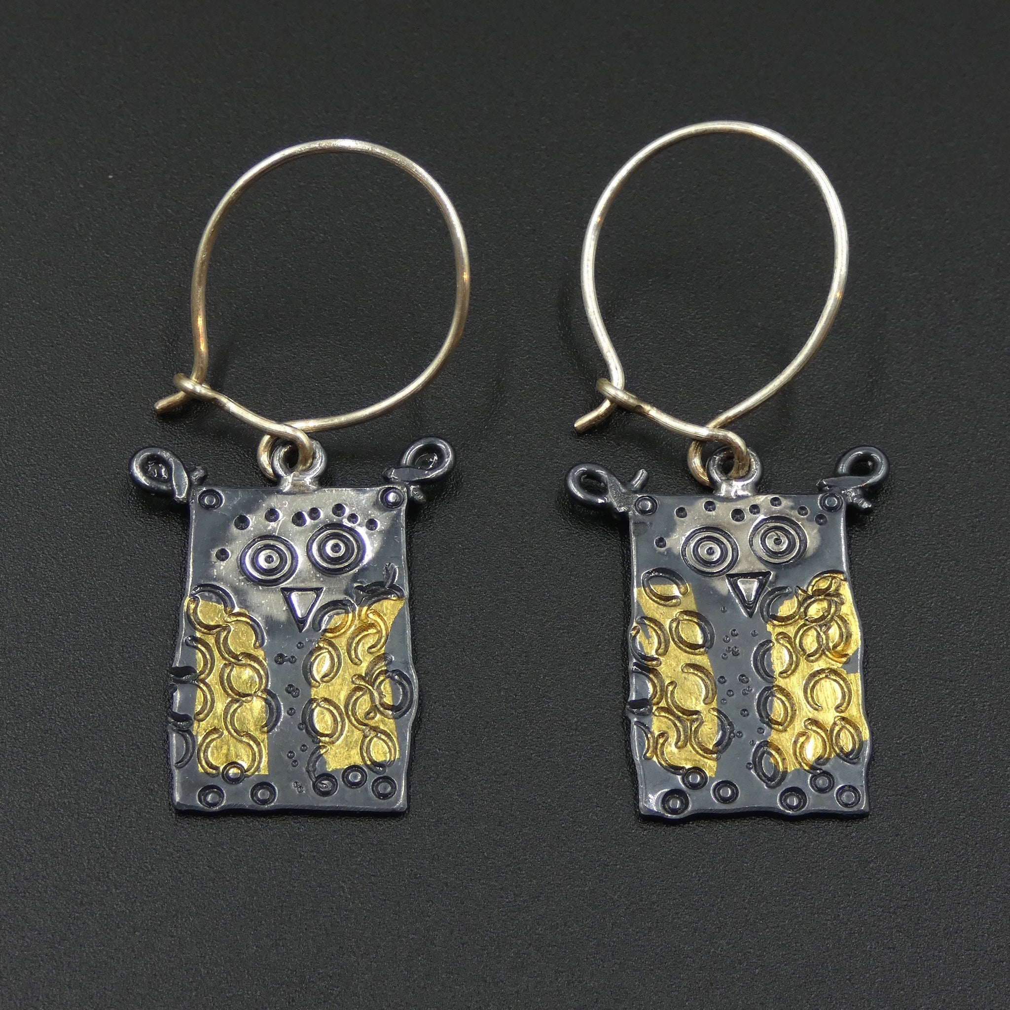 Owl earrings by jewellers John and Dawn Field