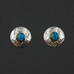 Round stud earrings by jewellers John and Dawn Field