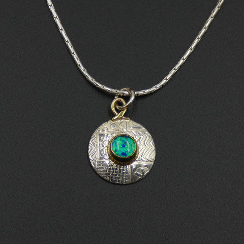 Small round pendant by jewellers John and Dawn Field