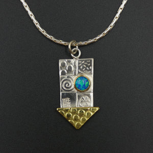 Medium pendant by jewellers John and Dawn Field