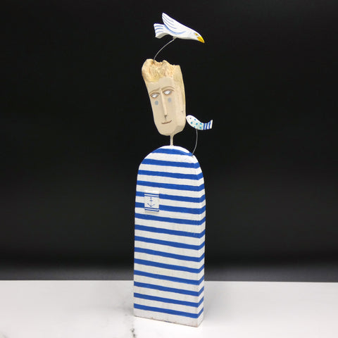 Driftwood sculpture of a man, seabird and fish by artist Lynn Muir.