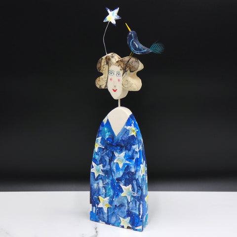 Driftwood sculpture of lady with bird and star on her hair by artist Lynn Muir.