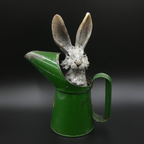 Sculpture of a hare hiding in an oil jug by artists Richard Ballantyne and Carol Read