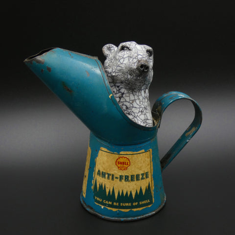 Sculpture of a Polar Bear keeping warm in an anti freeze jug by artists Richard Ballantyne and Carol Read