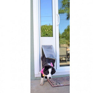 mikey the border collie puppy going through an endura flap quick panel 3 patio panel sliding glass door pet door insert