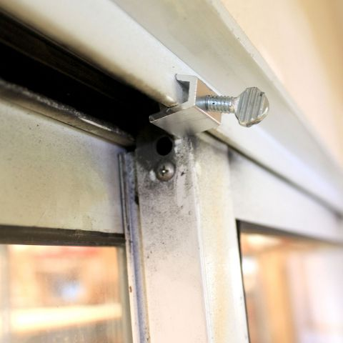 C-Clamp Lock Installed on the Top of a Sliding Glass Doors | Locks for Pet Doors