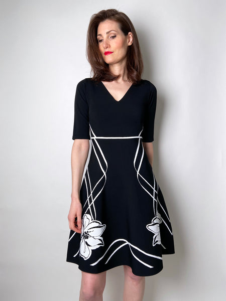 D. Exterior Black A-Line Dress with Floral Print