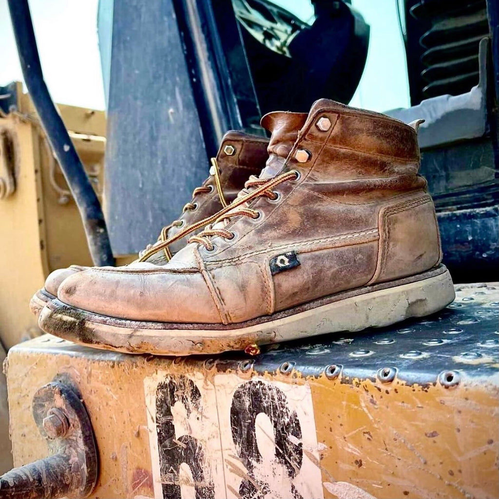 Used work boots on tractor