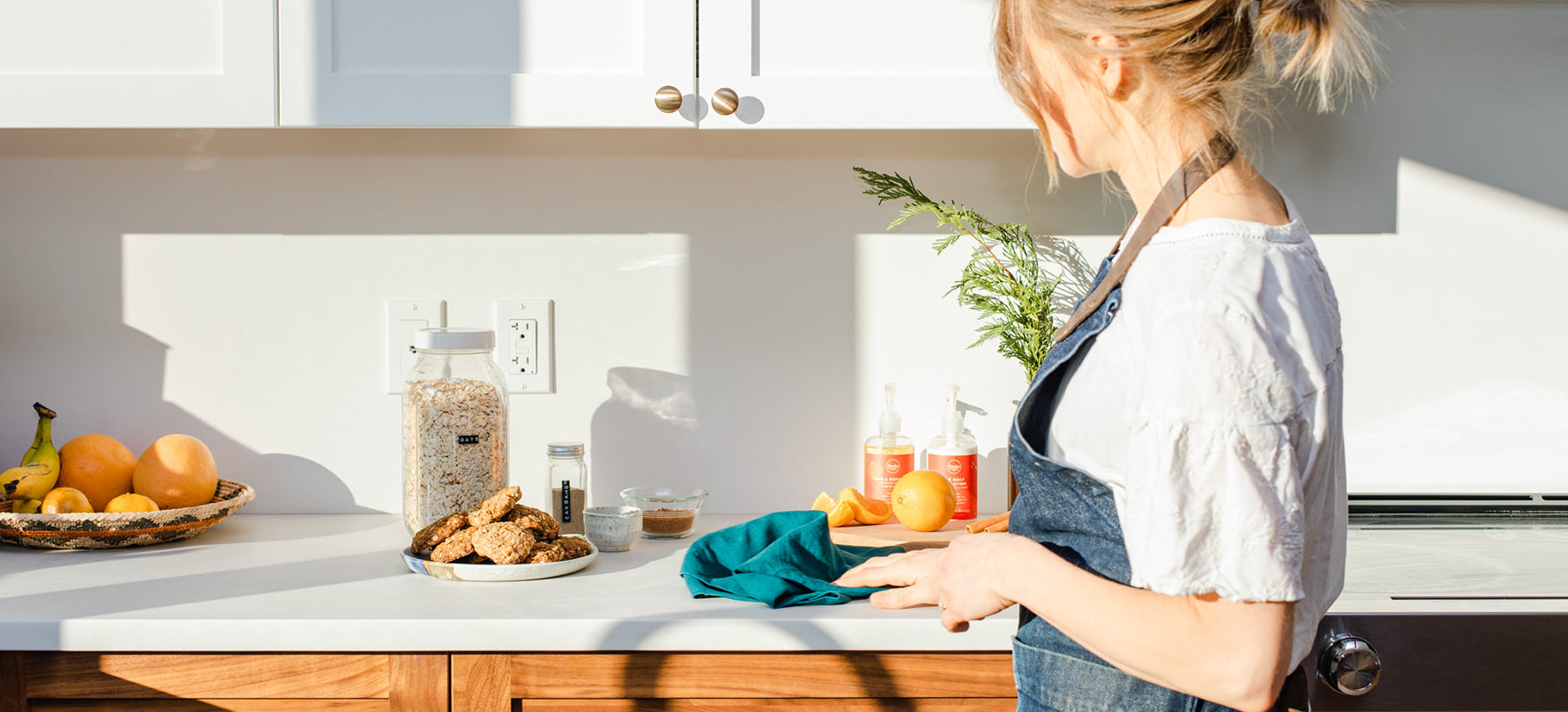 A woman is wiping her counter, getting her home ready for the holidays with all natural Rocky Mountain Soap products and inspiration from Marie Kondo.