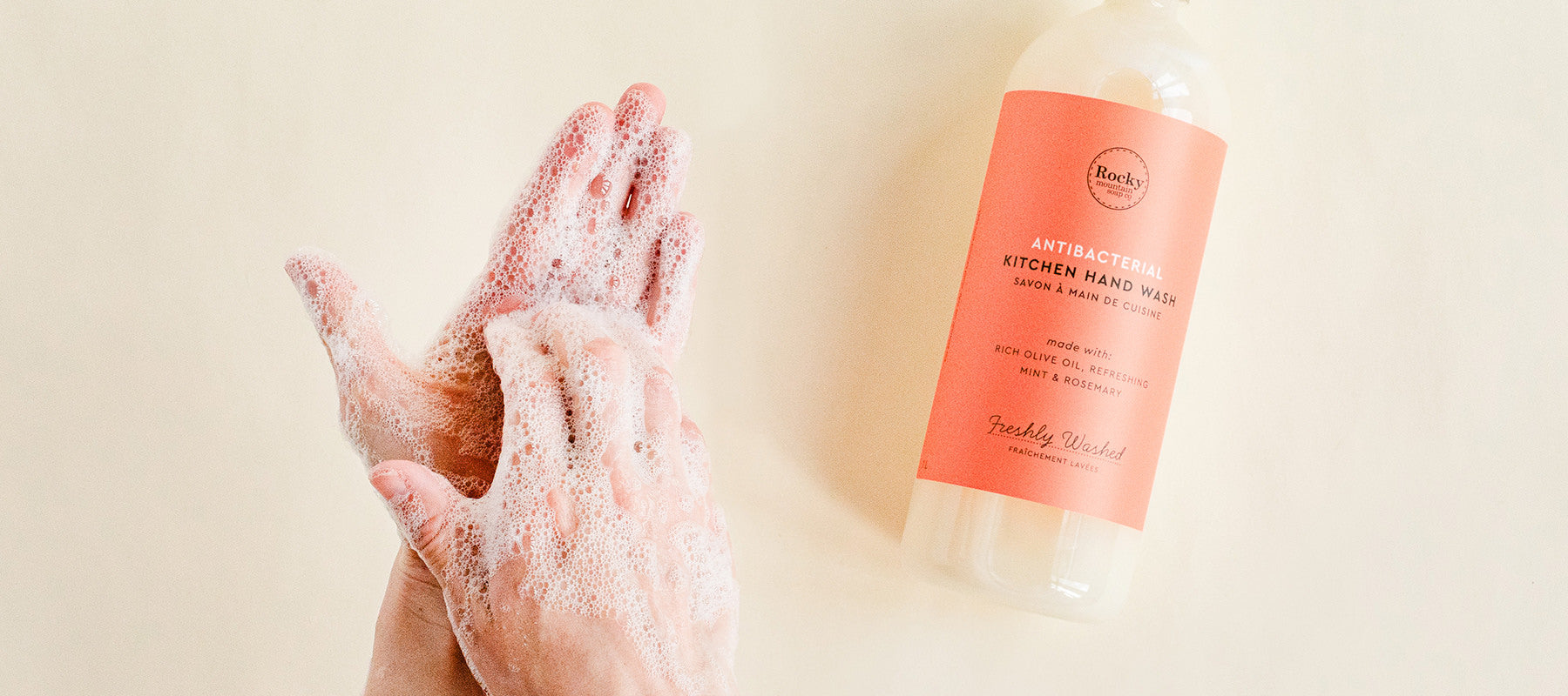 Image of two hands washing with natural antibacterial Kitchen hand wash.