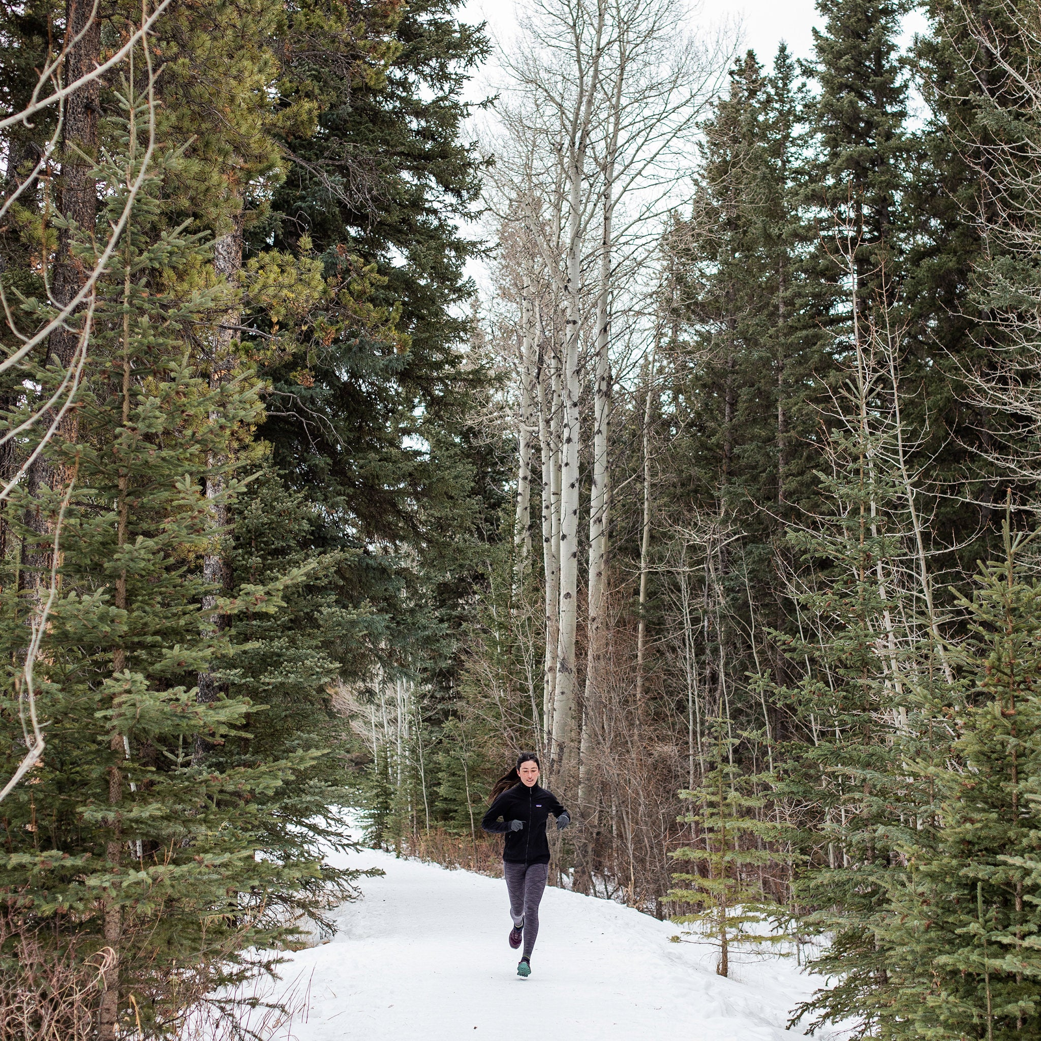 image of woman running in woods