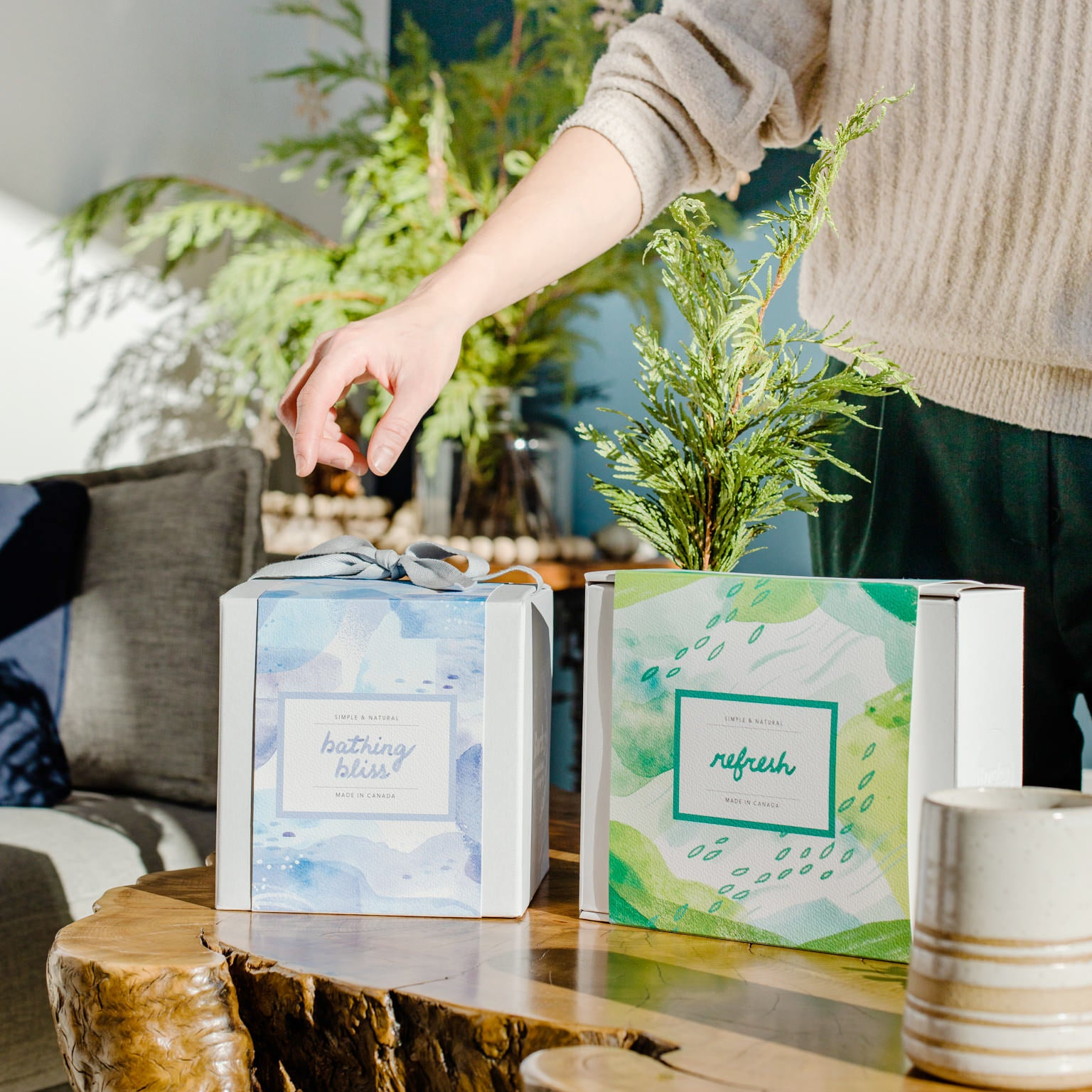 All-natural, made in Canada gift sets from Rocky Mountain Soap Company placed on a table as part of a holiday gift exchange like Secret Santa, White Elephant, or Draw Names.