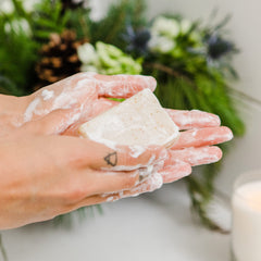 Image of Bar Soap lathering between two hands.