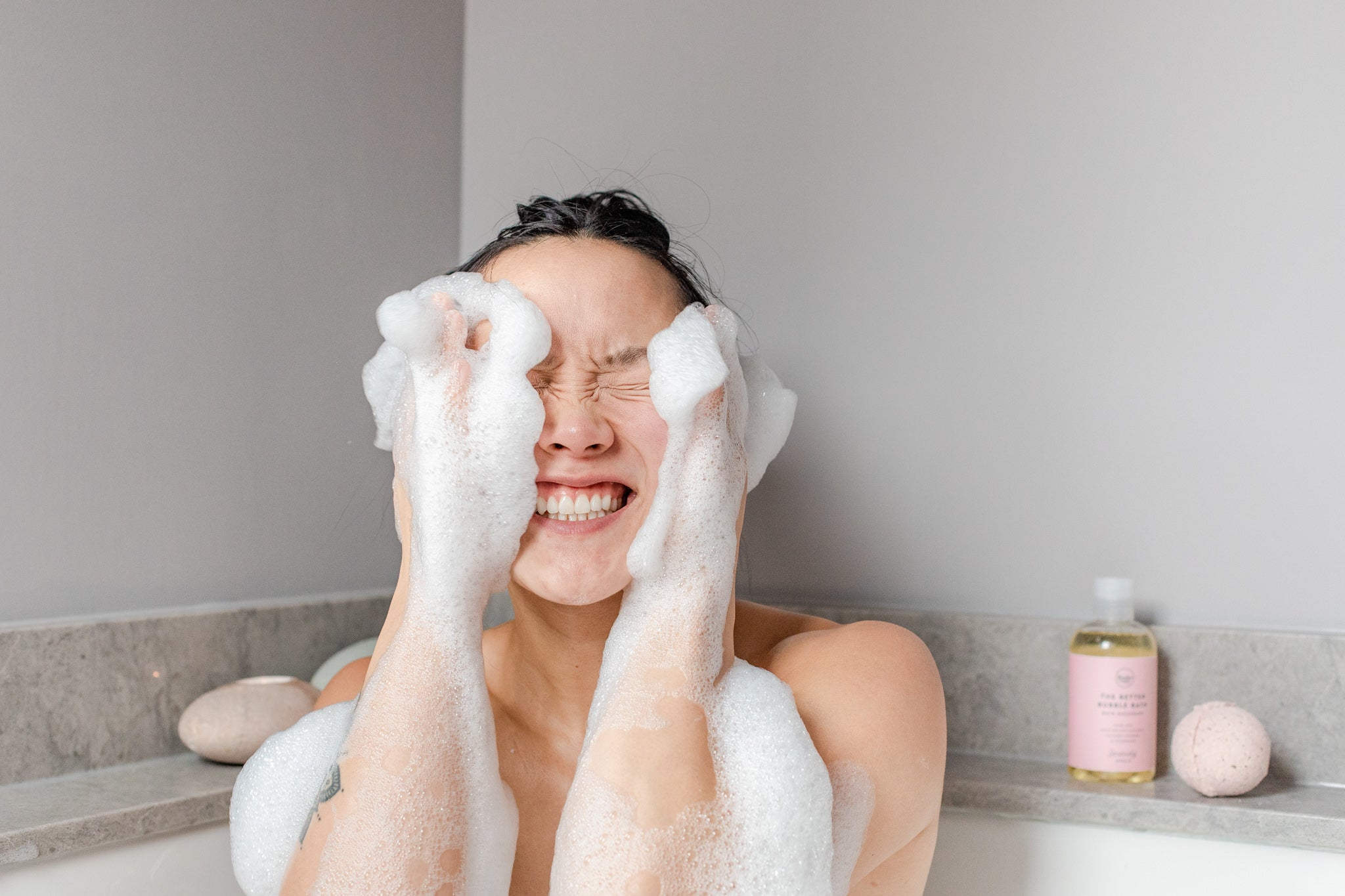 Image of woman and suds on her face with natural bubble bath