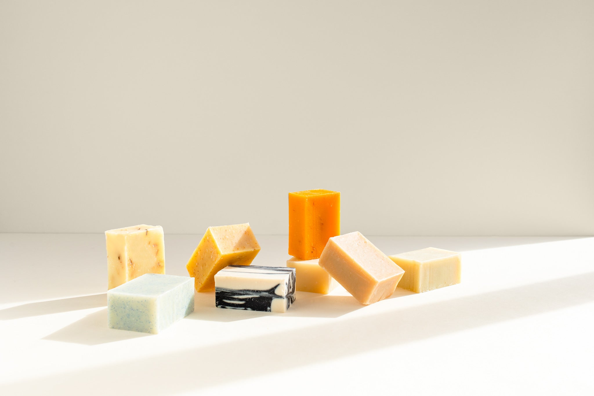 Multiple natural bar soaps.