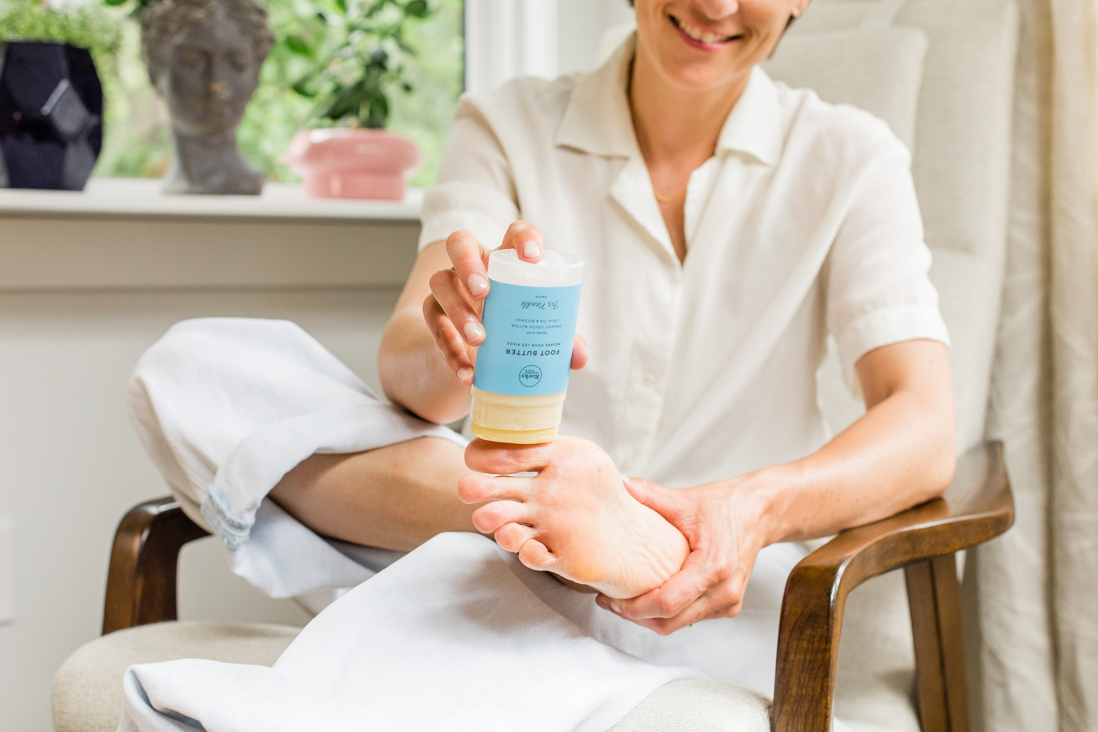 Karina Birch applying Rocky Mountain Soap Company Foot Butter to her foot.