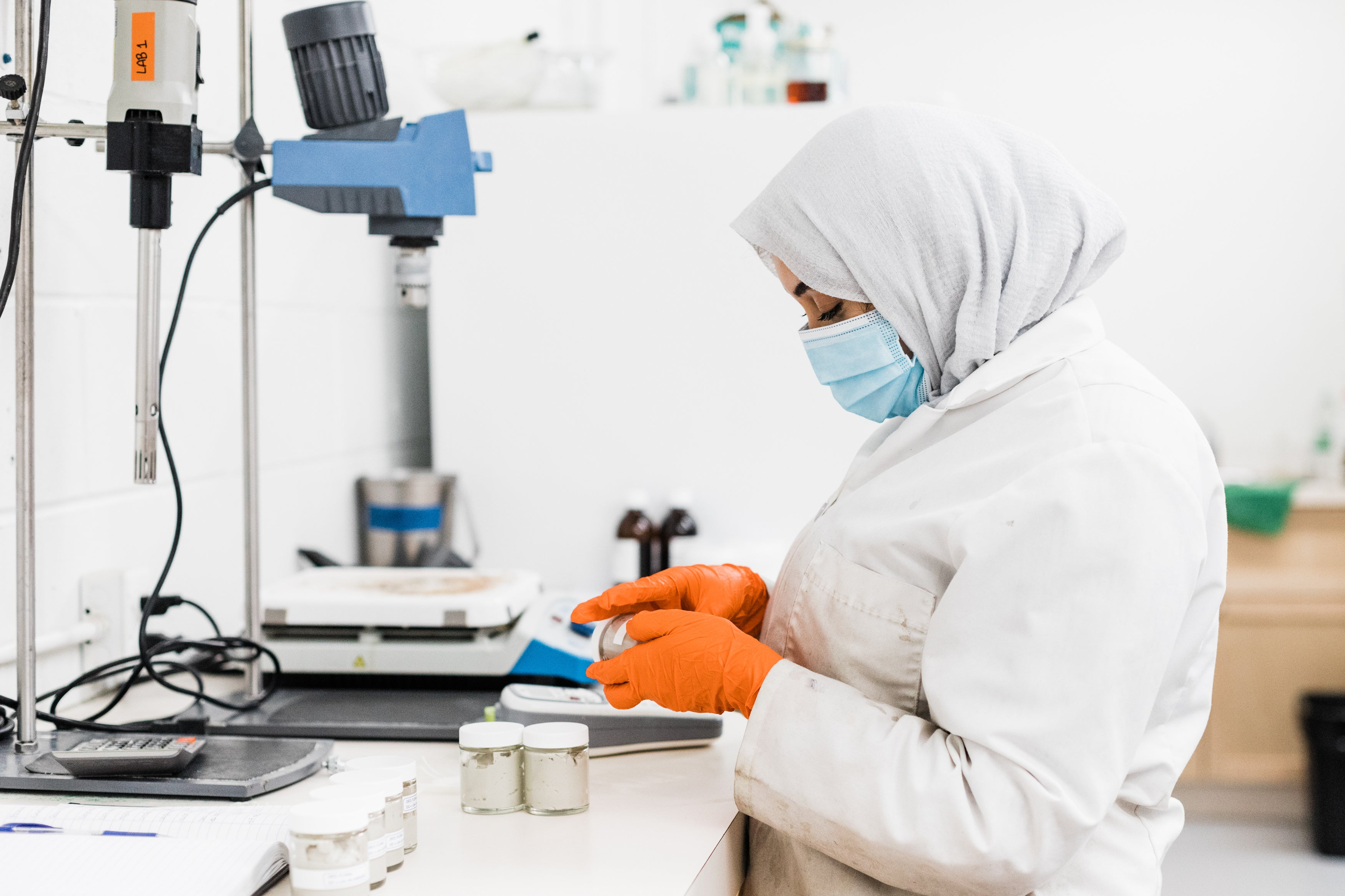 Image of woman wearing a hijab working in lab.