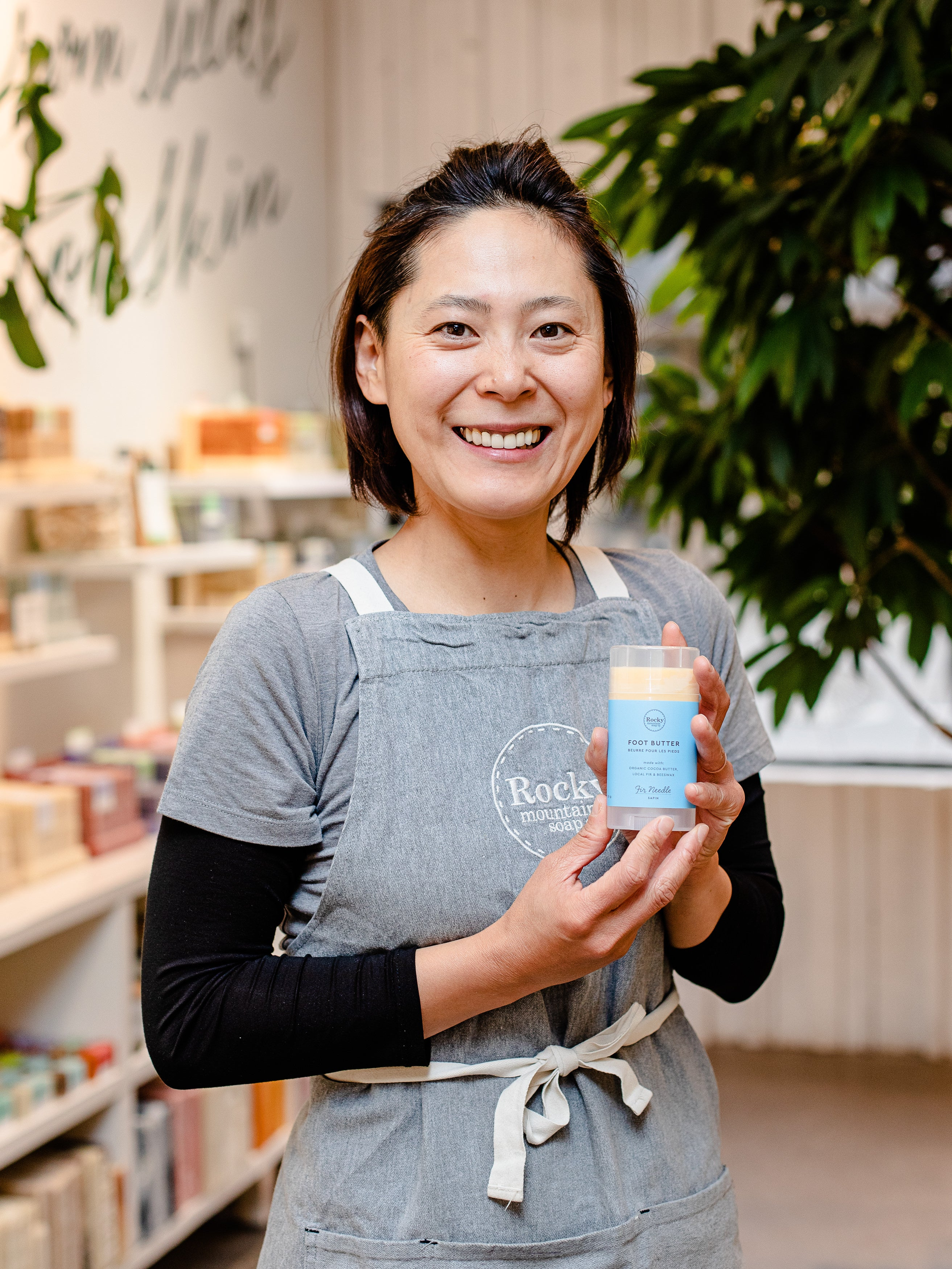 Image of woman holding all natural Foot Butter from Rocky mountain Soap Companay