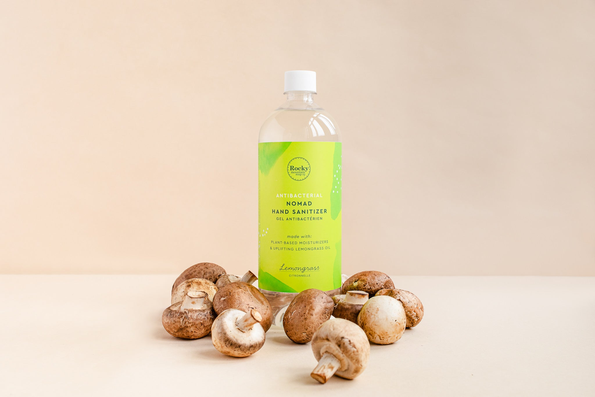 Image of 1 litre hand sanitizer surrounded by mushrooms.