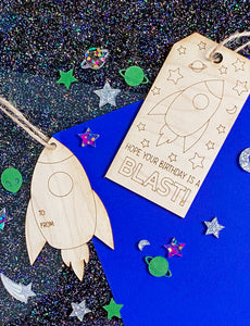 This particular sticker features a doodle Christmas sweater with alternating stripes of red and green patterns. The sticker has a thin white cut-line around the image and a glossy finish.