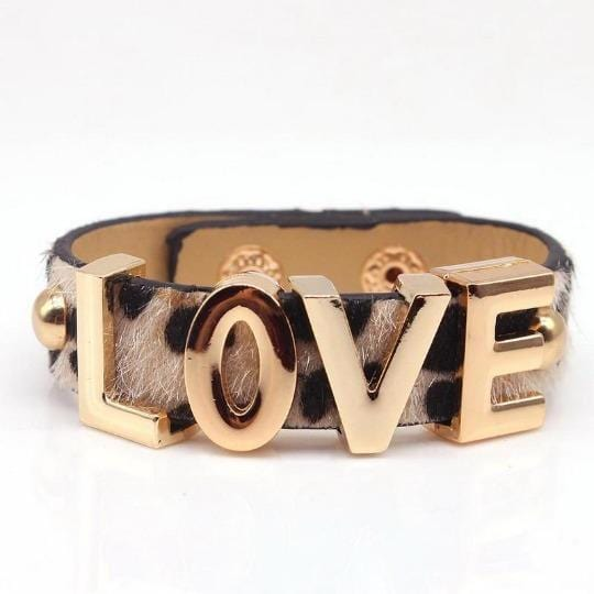 Leopard print LOVE cuff laying flat on white background