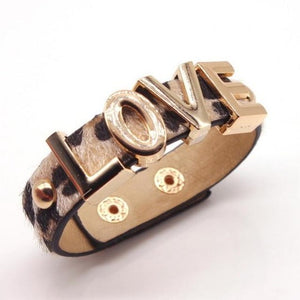 Leopard print LOVE cuff standing up on white background