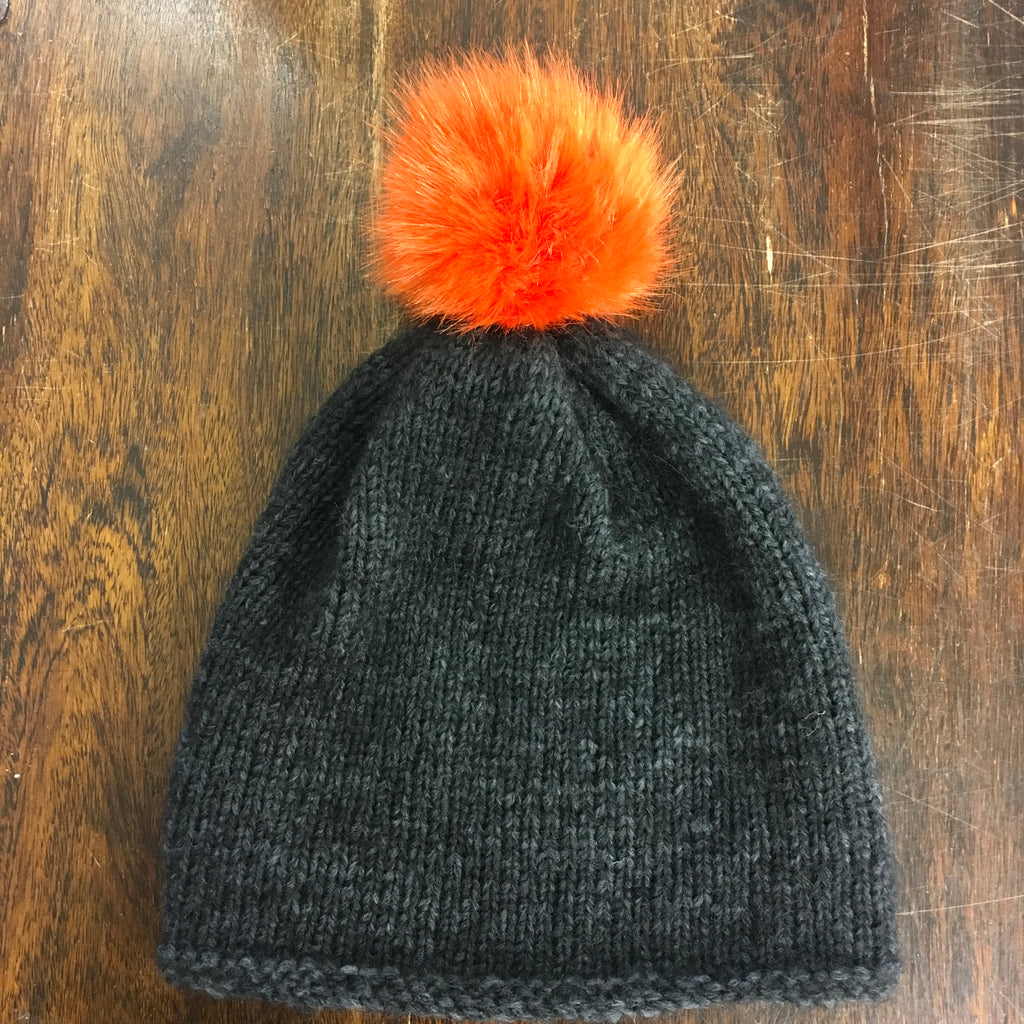 Free hat pattern in Rico alpaca superfine with orange Pom Pom at the woolly brew