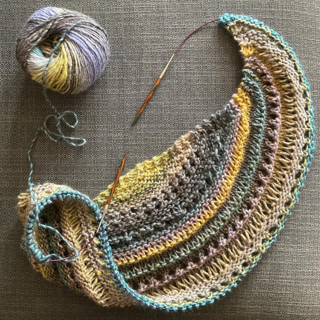 unfinished shawl in yellows and teals