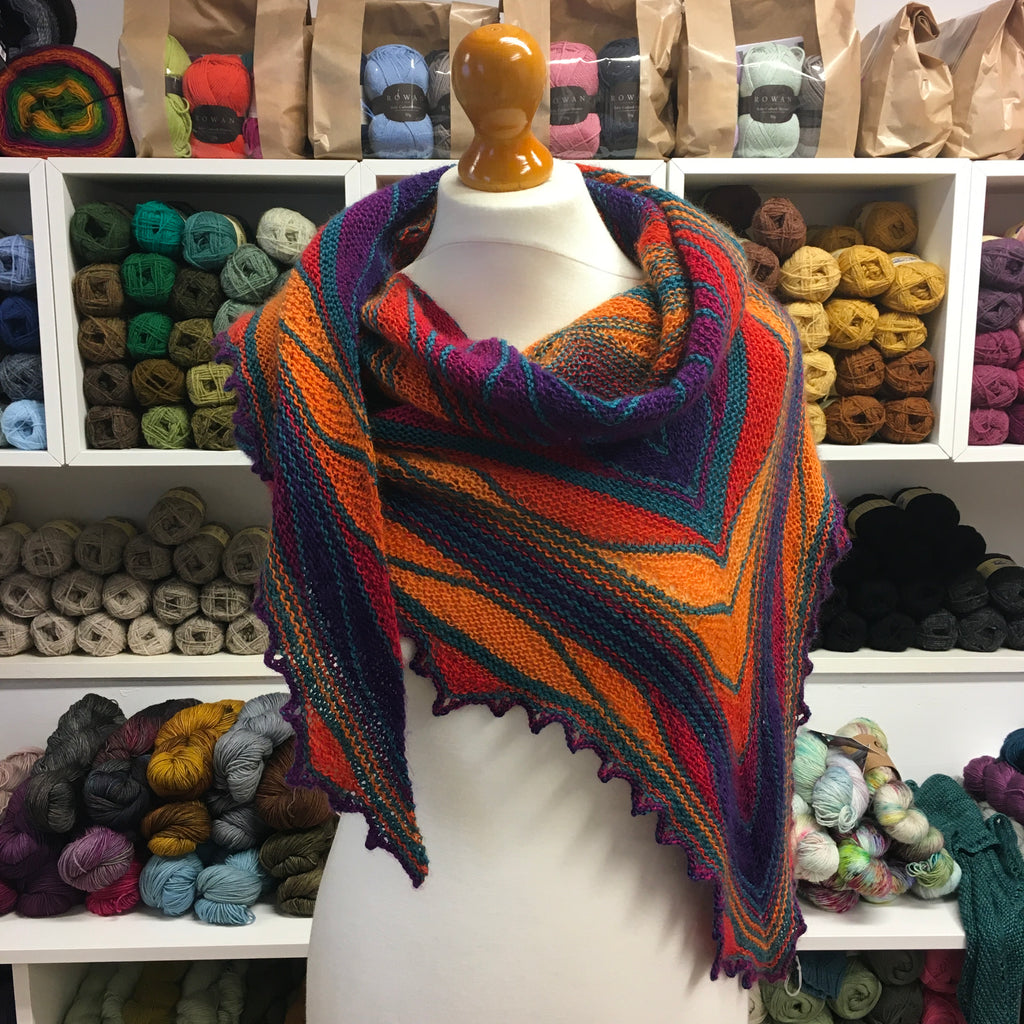 orange and purple Zauberball and teal socks yeah papillon shawl at the woolly brew