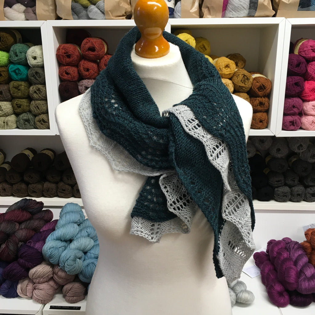 shawl with contrasting edges wrapped and tied around neck