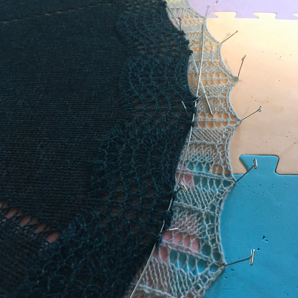 shawl with two edges pinned out