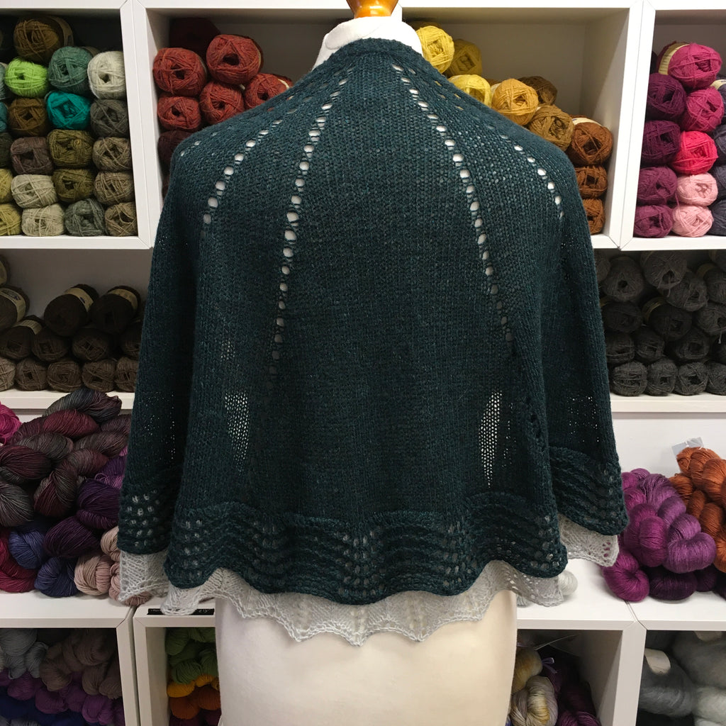 semi circle shawl shown from behind with a second contrast edge