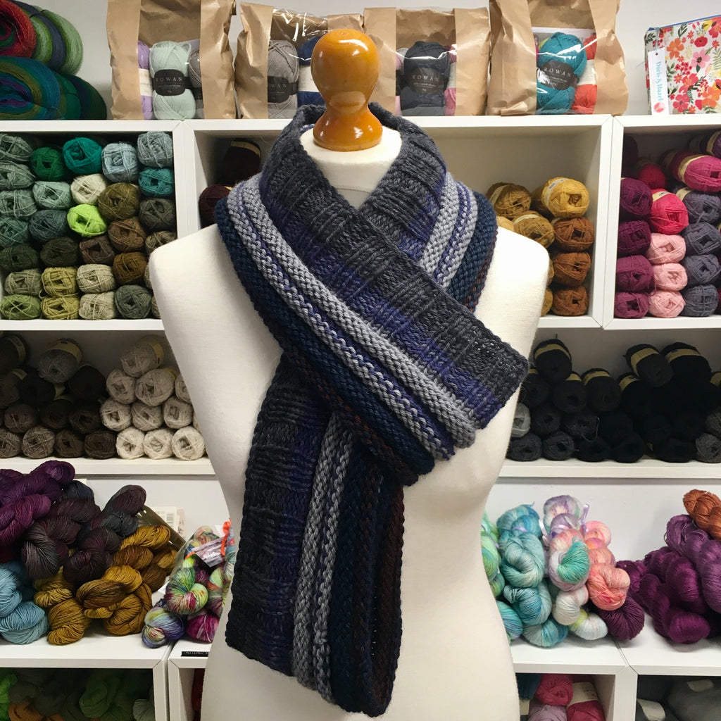 very long cowl in dark greys and blues worn like a scarf