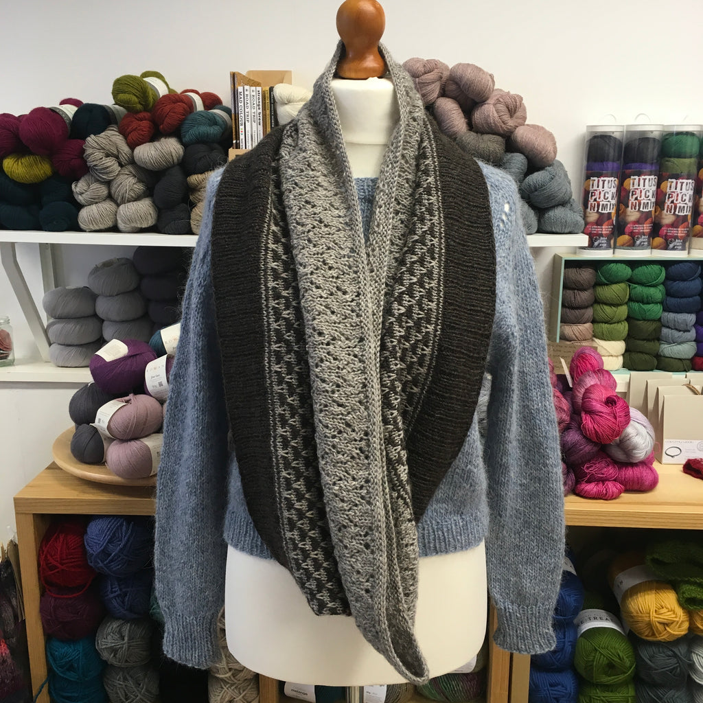 long handknitted cowl in shades of grey and brown