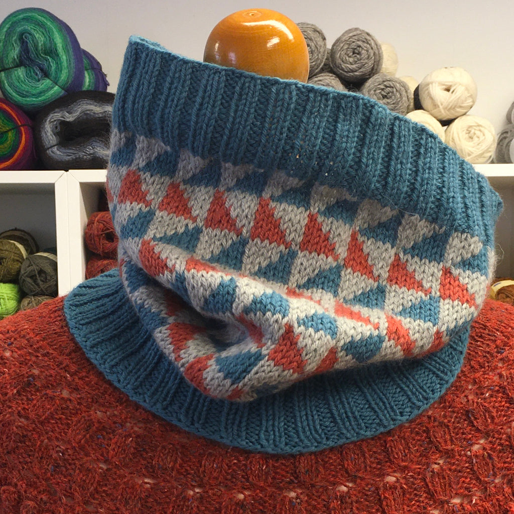 hand knit stranded colourwork cowl with orange, blue and grey triangles