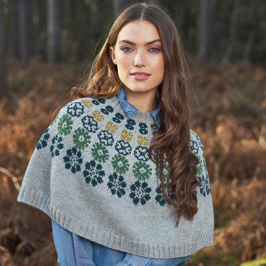 grey poncho with coloured flowers