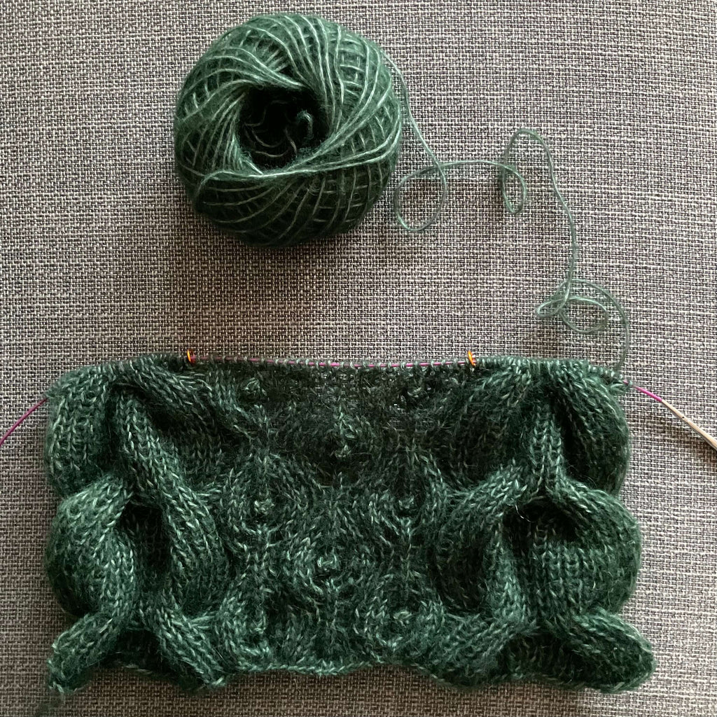 fluffy dark green hand knit with cables and lace