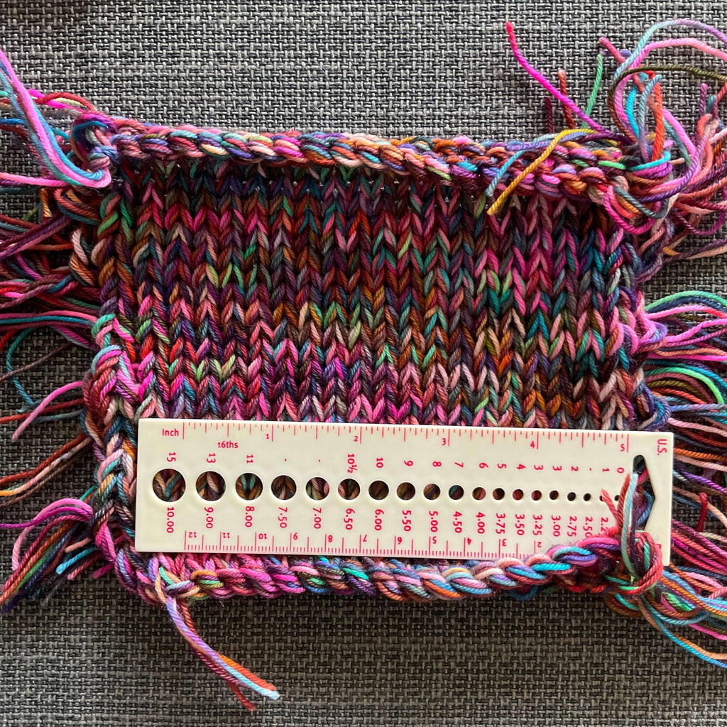 swatch of knitting with a ruler
