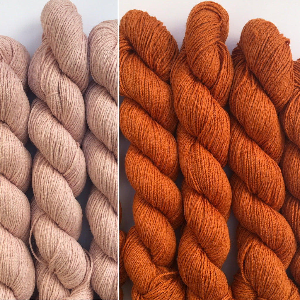 pale pink and orange wool in a hank