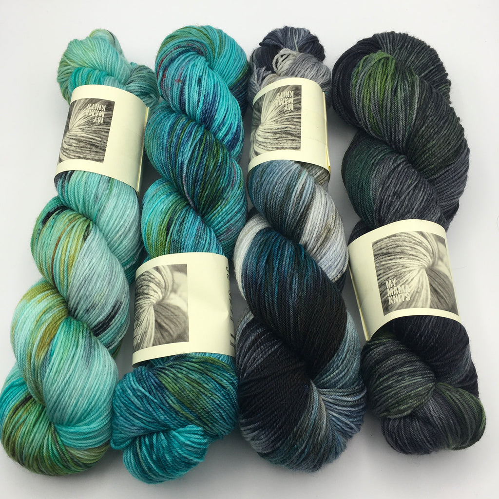 4 hanks of hand dyed yarn from turquoise to dark